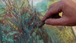 Close-up Footage. Painter Drawing A Picture of Autumn Landscape