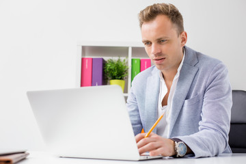 Handsome young businessman working with computer