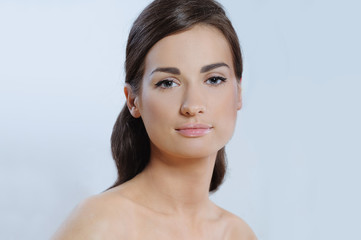 portrait of pretty young woman with perfect health skin