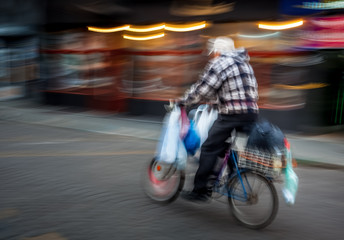 Old man riding a bicycle