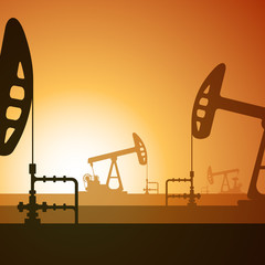 Oil pumps silhouette on sunset