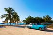 Leinwanddruck Bild - Old classic car on the beach of Cuba