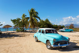 Fototapety Old classic car on the beach of Cuba