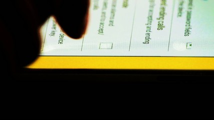man usie finger for selecting checkboxes on tablet pc