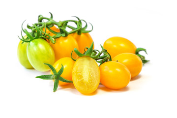 Fresh yellow grape tomato isolated on white background