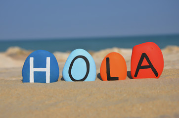 Hola, hello in spanish language on colored stones