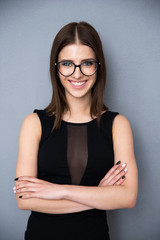Smiling fashion woman with arms folded