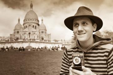 France, Paris, young man taking photograph, Sacre Coeur in backg