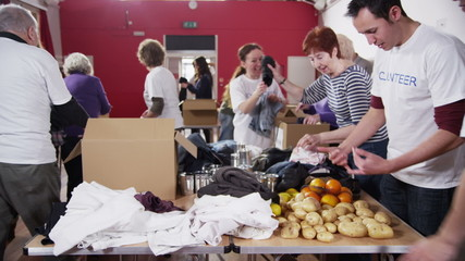 Time lapse clip of charity volunteers and community members working together
