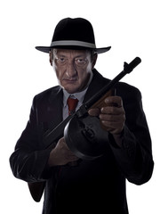 Old style gangster with tommy gun, on white background