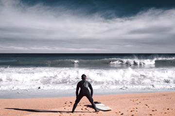Surfer is getting ready fro surfing