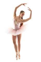 Young classical dancer isolated on white background. Ballerina p