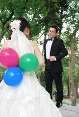 Bride with colored balloons in their hands
