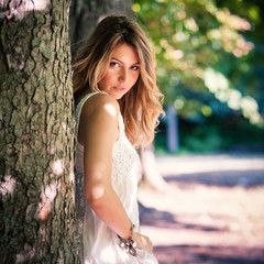 Sensual young woman portrait outdoors in the park.