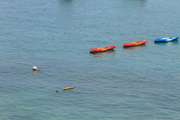 Colourful kayaks on tropical sea