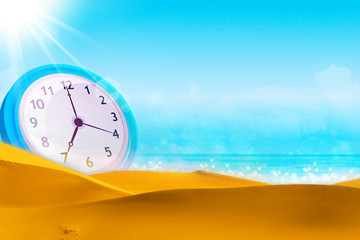 Time concept. Summer time. Alarm clock on the beach