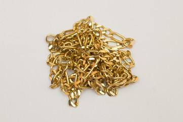 Gold necklace in pile