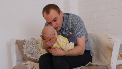 loving dad with the baby in his arms