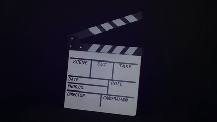 Movie clapper is rotated on a black background