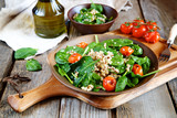 Fresh spinach salad with quinoa and roasted tomatoes