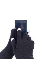 Closeup of woman hands with touchscreen gloves holding smart pho