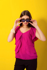 Beautiful young girl with long hair in a purple blouse