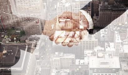 Composite image of handshake between two business people