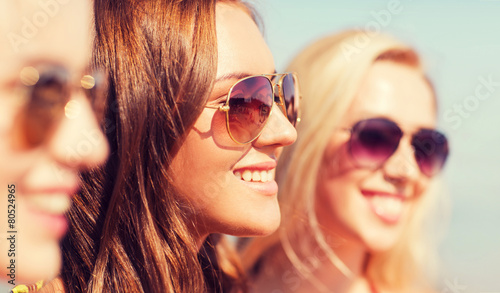 close up of smiling young women in sunglasses - 80524965