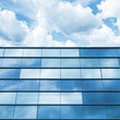Blue mirrored glass and cloudy sky, office facade - 80525198