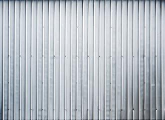 Shining ridged garage metal wall, background texture