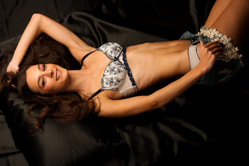 Portrait of a young beautiful brunette woman in lingerie