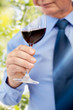 close up of senior man drinking wine from glass