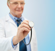 close up of doctor in white coat with stethoscope