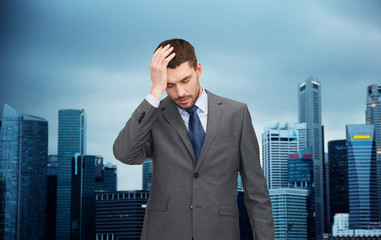 young businessman having headache