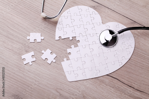 Leinwanddruck Bild Stethoscope and puzzle, concept of Solution