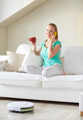 happy woman with smartphone drinking tea at home