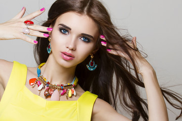 beautiful woman portrait with long hair and jewelry