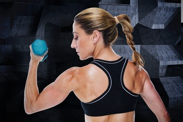 Composite image of female bodybuilder holding a dumbbell