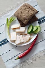 snack of fresh lard, bread, green onion and cucumber