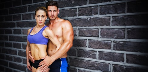Composite image of bodybuilding couple