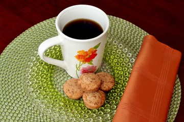 A cup of coffee and mini muffins
