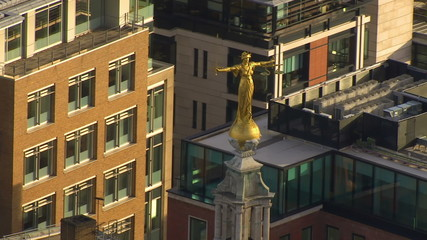 Aerial view of Lady Justice, opening out to a wide shot of London