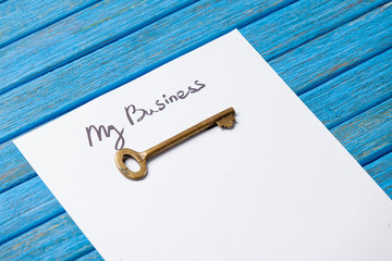 Key and paper with My Business words