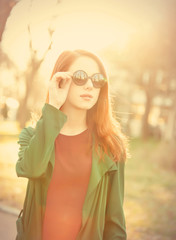 Style redhead girl in sunglasses