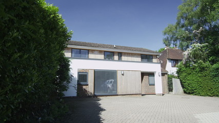 Exterior view of a detached modern home on a bright sunny day