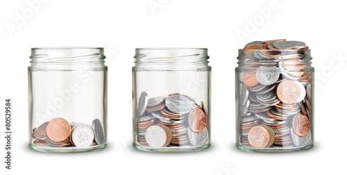 jars with different level of coins isolated on white - 80529584