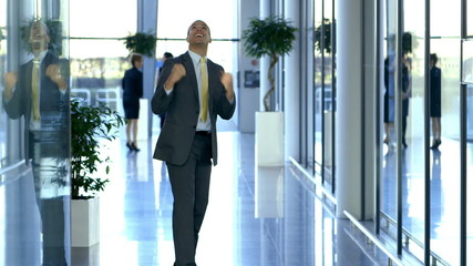 Happy and excited businessman punches the air