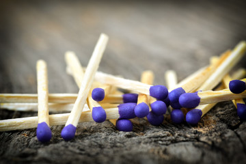 A lot of matchstick on a textured wood background