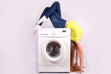 A girl and a washing machine