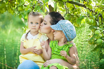 Family are relaxing in forest with her daughters